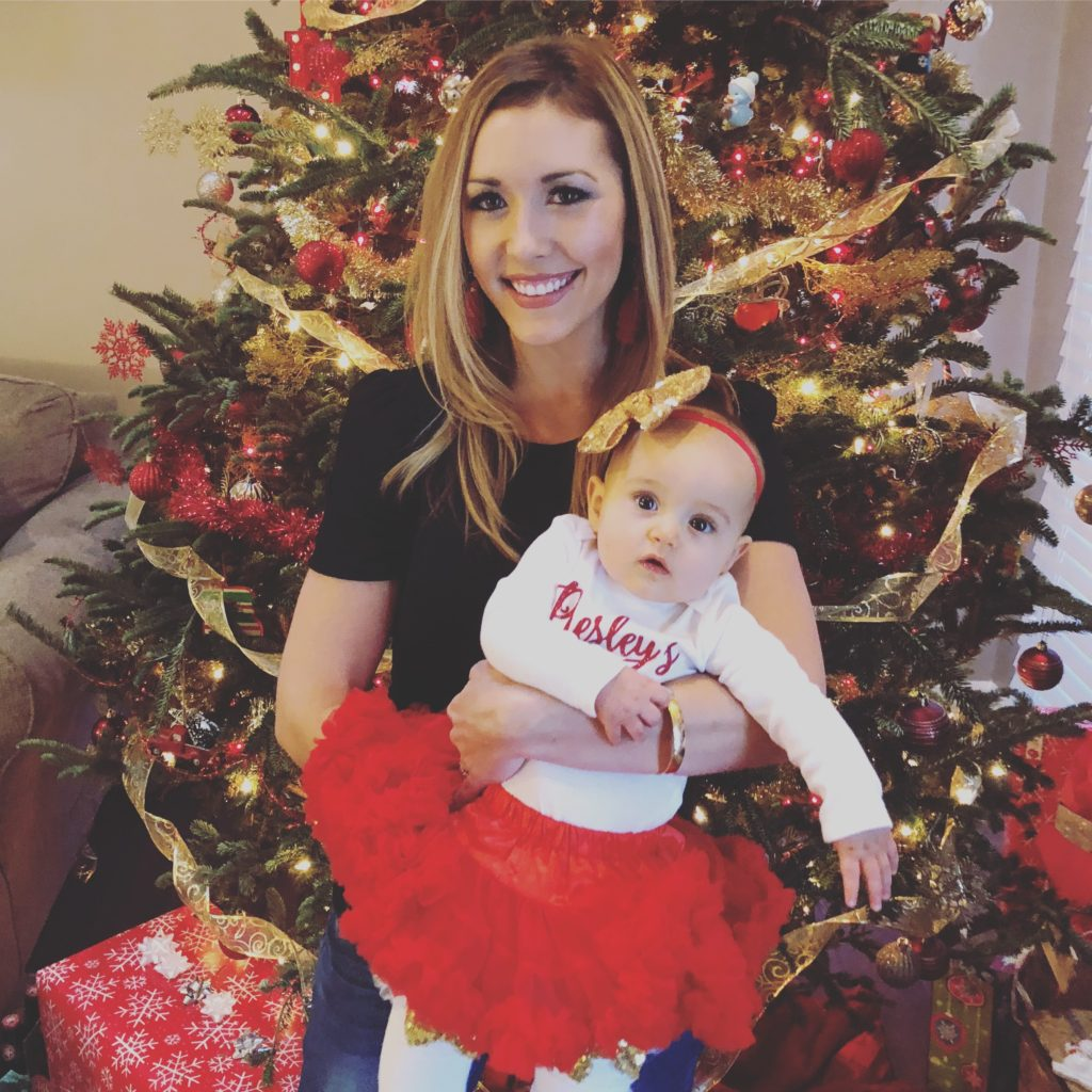 Brianna K and Presley in front of the tree on Christmas Day 2017 - baby P's first christmas