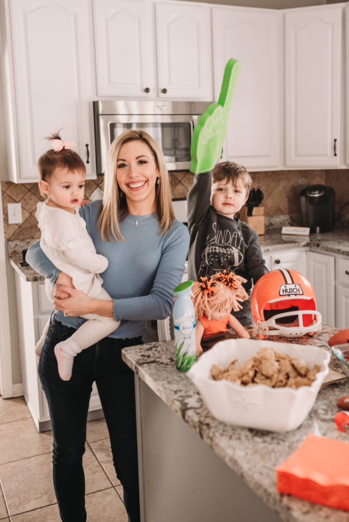 Brianna K Landon and Presley in the kitchen ready to eat delicious super bowl party recipes cheddar bacon dip and black bean corn salsa and using febreze for party prep and party clean up with lots of football decor