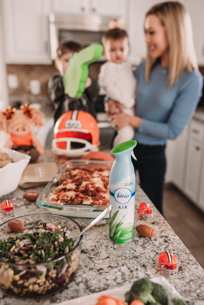 party prep with Febreze and Brianna K bitsofbri in her kitchen sharing extremely easy and delicious crowd pleaser football game recipes cheddar bacon taco dip and black bean corn salsa with football decor on kitchen island