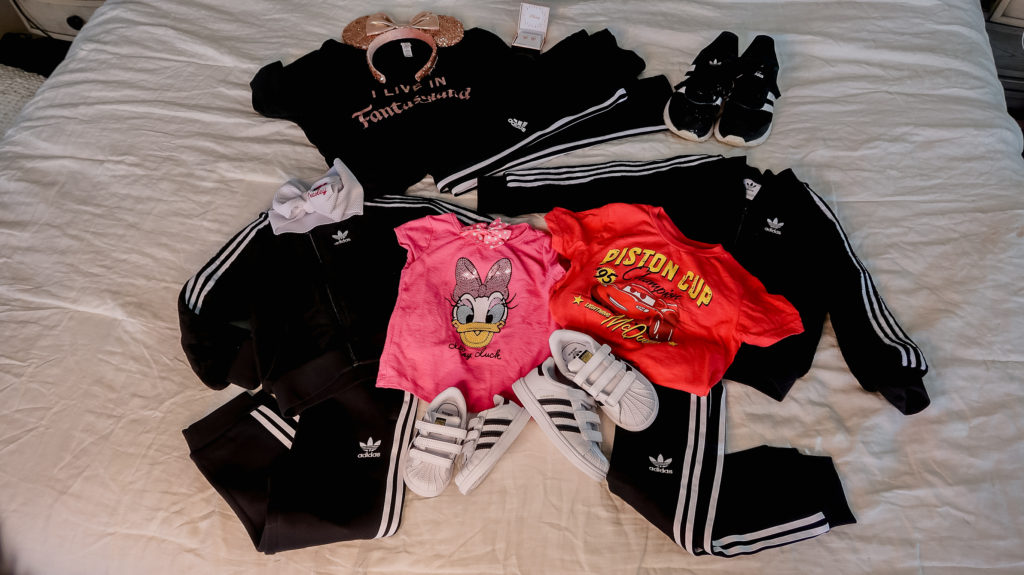 what to wear to disney travel outfit for the plane disney magical express Adidas track suit track pants disney lightning McQueen Daisy Duck I live in fantasyland graphic tees toddler boy mom shirt brother sister coordinating shirts what to wear to disney for a family outfit ideas coordinating disney clothing wardrobe  outfits  Brianna K bitsofbri