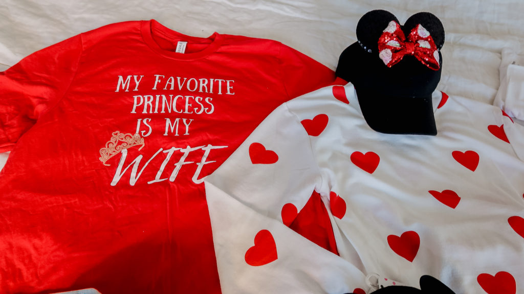 what to wear to disney for a family outfit ideas coordinating disney clothing wardrobe magic kingdom Valentine's Day outfits monogram heart sweater Brianna K bitsofbri favorite disney princess is my wife tee shirt