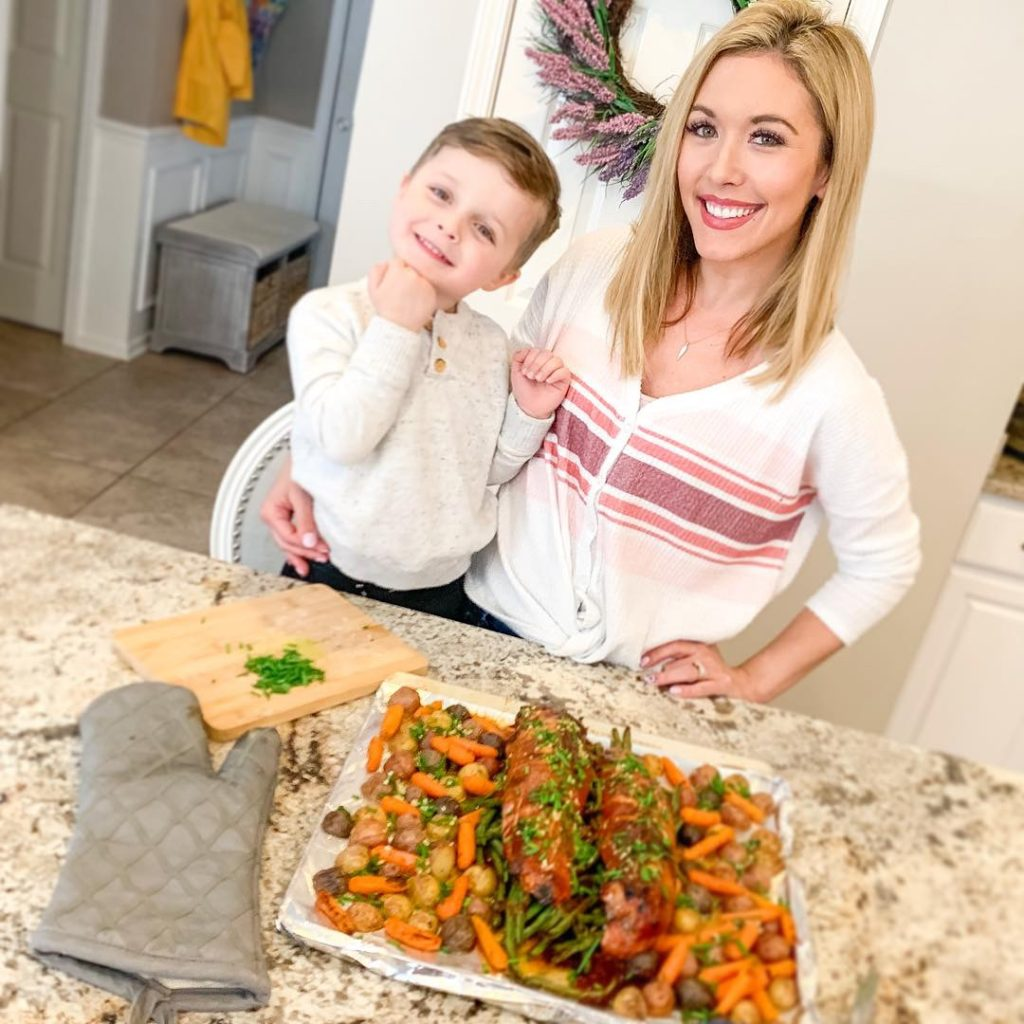 Brianna K and son Landon cooking pork recipe in the kitchen! Easy one-pan pork recipe and family meal idea! Sliced pork tenderloin with hoisin glaze and veggies- carrots potatoes and green beans with chive butter sauce. Brianna K bitsofbri cook with me family recipe meal idea blog post