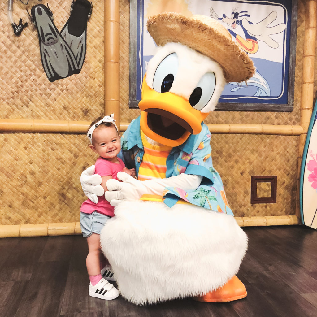 Presley with Donald Duck at the PCH Grill Character breakfast at the Paradise Pier Hotel September 2018. Disneyland vacation planning tips and tricks from a Disney Pro. Brianna K Bitsofbri bits of bri Cleveland mom blog Disneyland planning advice where to stay what to eat what age to go to disney