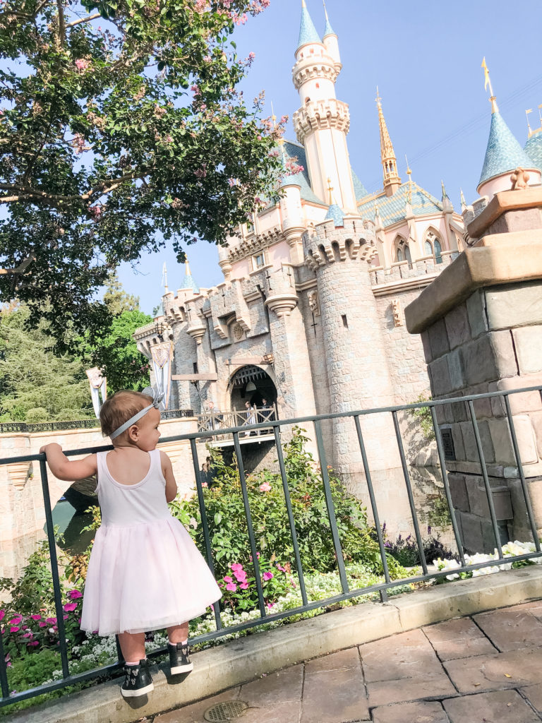 Presley in front of Sleeping Beauty's castle at Disneyland on our trip in September 2018. Disneyland vacation planning tips and tricks from a Disney Pro. Brianna K Bitsofbri bits of bri Cleveland mom blog Disneyland planning advice where to stay what to eat what age to go to disney