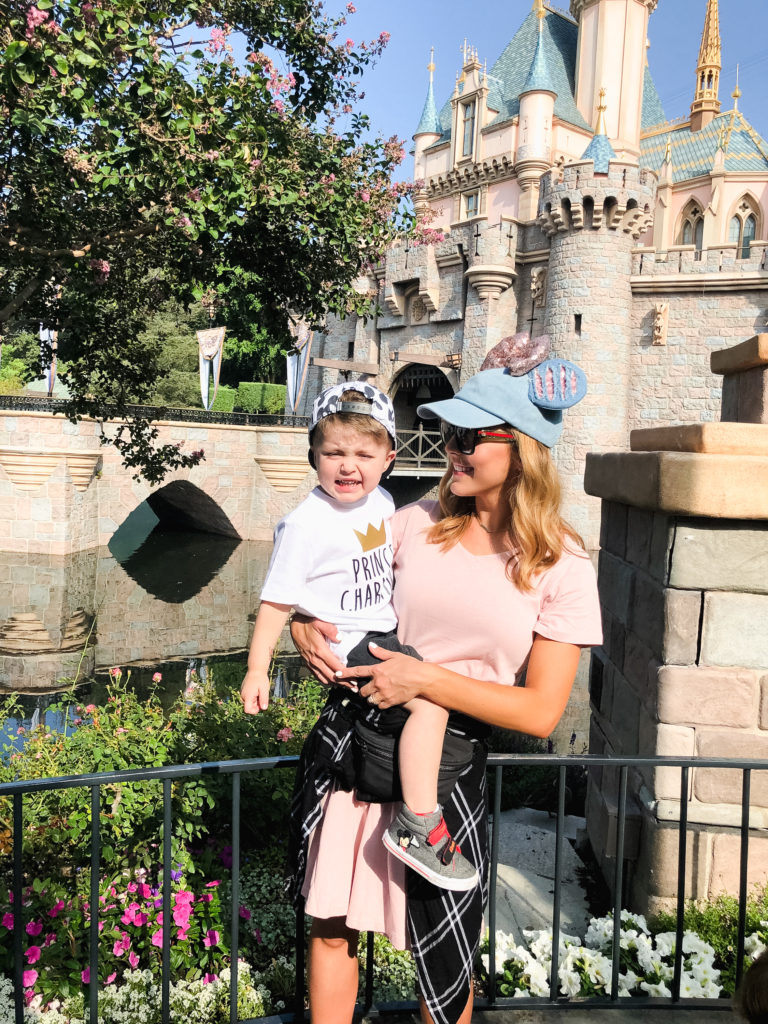 Brianna K and Landon in front of the Disneyland California Sleeping Beauty Castle before it was painted fall 2018 Disney blog