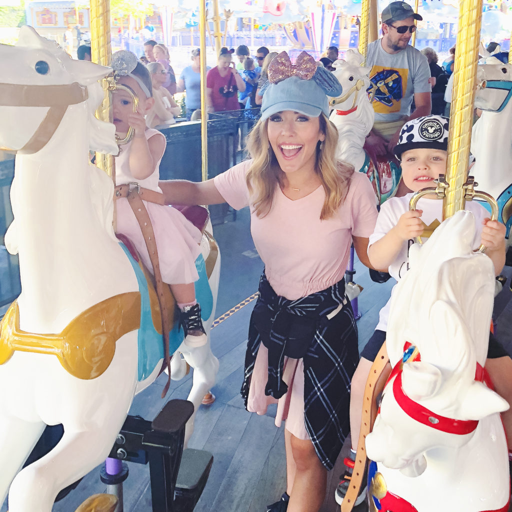 Landon, Presley, and me on the carousel at Disneyland in September 2018. Disneyland vacation planning tips and tricks from a Disney Pro. Brianna K Bitsofbri bits of bri Cleveland mom blog Disneyland planning advice where to stay what to eat what age to go to disney