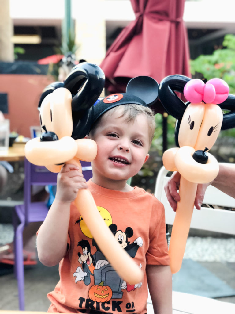 Landon with balloons made table side at Tortilla Jo's a Mexican restaurant at Downtown Disney. Disneyland vacation planning tips and tricks from a Disney Pro. Brianna K Bitsofbri bits of bri Cleveland mom blog Disneyland planning advice where to stay what to eat what age to go to disney