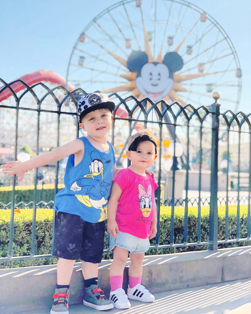 Landon and Presley in front of the Pixar-Pal-Around Ferris Wheel at Disney's California Adventure park on our last trip in September 2018. Disneyland vacation planning tips and tricks from a Disney Pro. Brianna K Bitsofbri bits of bri Cleveland mom blog Disneyland planning advice where to stay what to eat what age to go to disney