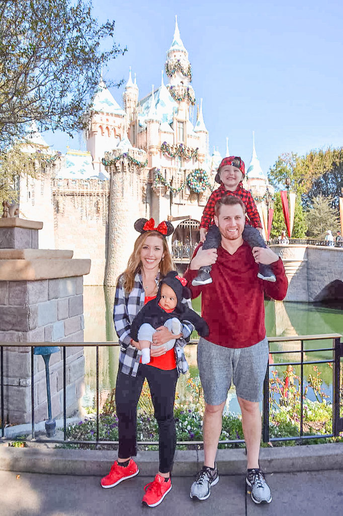 Me, Adam, Landon, and Presley in front of Sleeping Beauty's castle at Disneyland in December 2017. This was Presley's first time at Disneyland, and we were celebrating my 30th birthday! All of the Christmas decorations were on the castle too, so it was a really fun time to be there! Disneyland vacation planning tips and tricks from a Disney Pro. Brianna K Bitsofbri bits of bri Cleveland mom blog Disneyland planning advice where to stay what to eat what age to go to disney