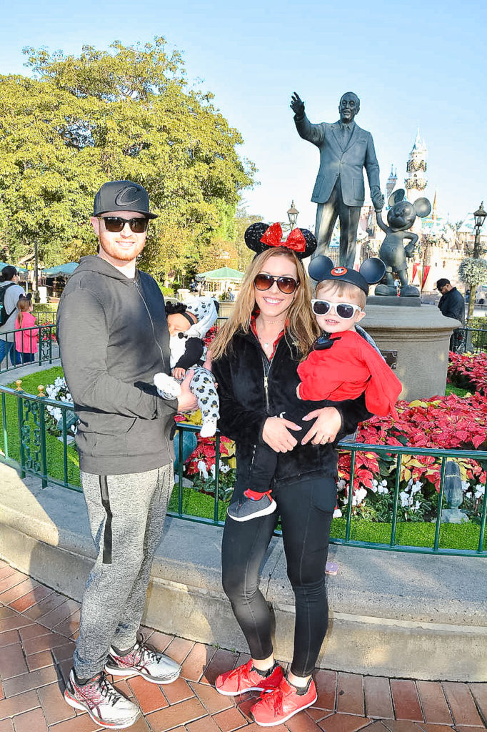 Our family at Disneyland for my 30th birthday in December 2017. Princess Presley had so much fun her first time at Disneyland she was passed out in Daddy's arms! Disneyland vacation planning tips and tricks from a Disney Pro. Brianna K Bitsofbri bits of bri Cleveland mom blog Disneyland planning advice where to stay what to eat what age to go to disney