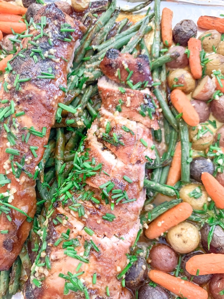 Easy one-pan pork recipe and family meal idea! Sliced pork tenderloin with hoisin glaze and veggies- carrots potatoes and green beans with chive butter sauce. Brianna K bitsofbri cook with me family recipe meal idea blog post