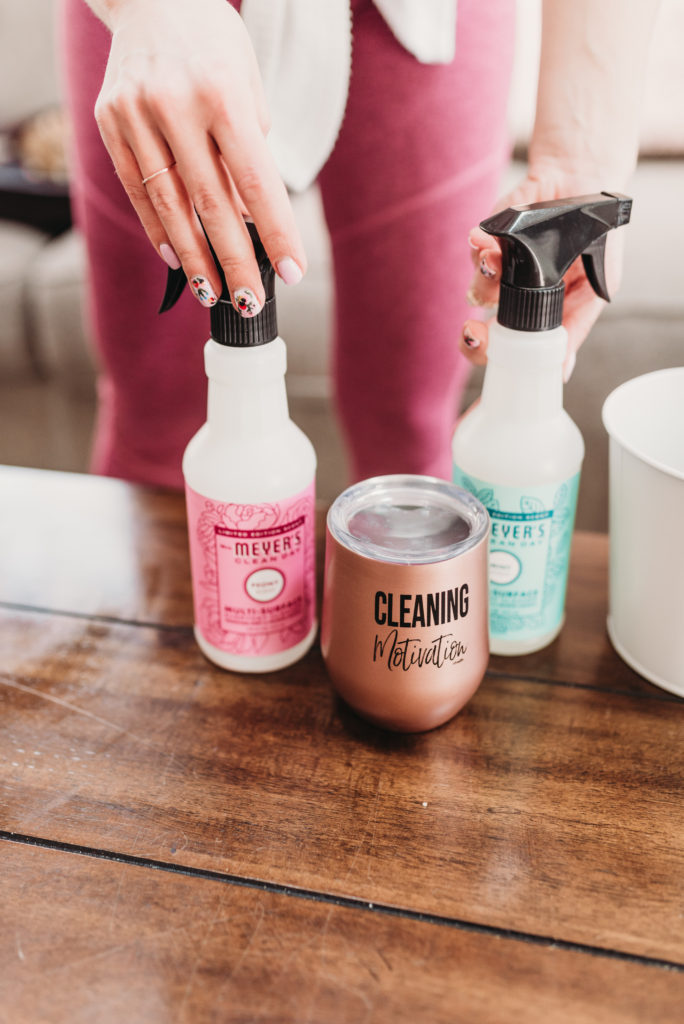 Brianna K cleaning a table in her family room with Mrs Meyers peony multi surface spray and cleaning motivation rose gold tumbler cup clean with me spring cleaning check list bits of bri blog