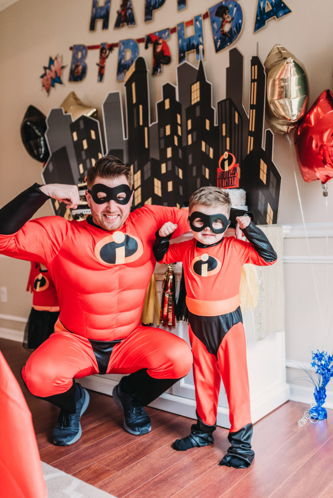 Adam and Landon K family showing muscles dressed as mr. incredibles and dash for landon's incredibles birthday party HOW TO PLAN AN INCREDIBLE BIRTHDAY PARTY | BE YOUR OWN PARTY PLANNER CHECKLIST! Brianna K bitsofbri blog