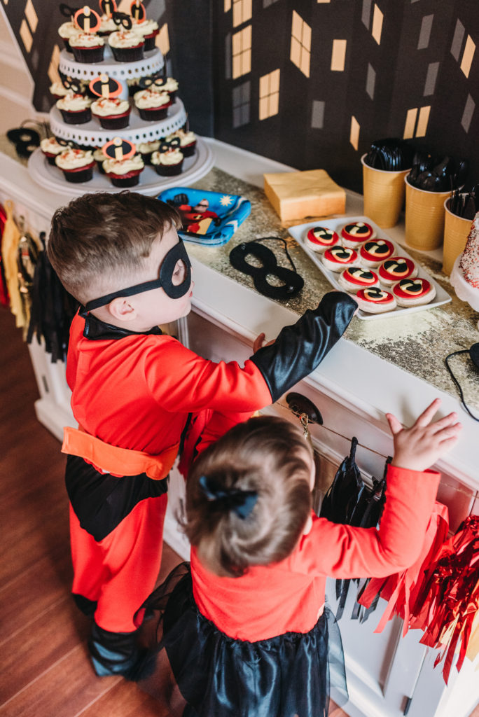Landon and Presley checking out the dessert table at Landon's 4th birthday party with incredibles theme decor HOW TO PLAN AN INCREDIBLE BIRTHDAY PARTY | BE YOUR OWN PARTY PLANNER CHECKLIST! Brianna K bitsofbri blog