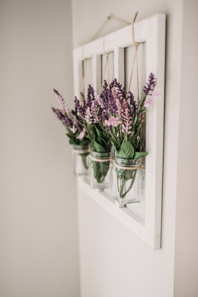 purple and mauve flowers in hanging glass jars in kitchen  Brianna K bits of bri bitsofbri easter decor house tour 2019 spring and easter decorations around her home flowers bunnies dollar tree DIY decorations