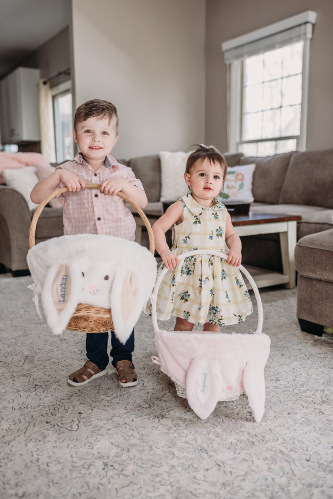 Landon and Presley holding their easter baskets from pottery barn kids  Brianna K bits of bri bitsofbri easter decor house tour 2019 spring and easter decorations around her home flowers bunnies dollar tree DIY decorations