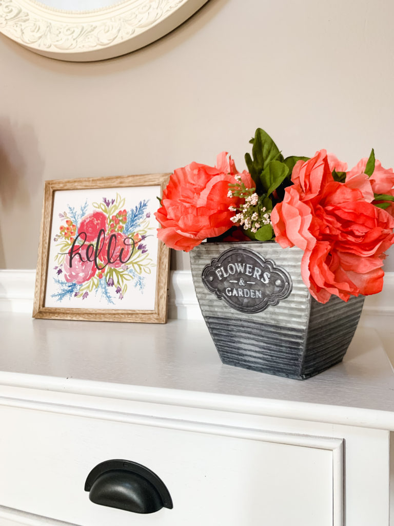 flowers and hello sign in foyer for Brianna K house tour  Brianna K bits of bri bitsofbri easter decor hour tour 2019 spring and easter decorations around her home flowers bunnies dollar tree DIY decorations