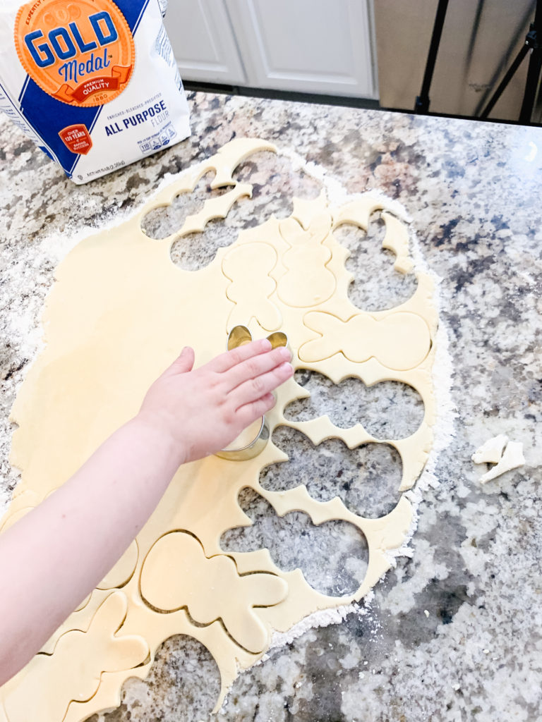 Brianna K's son Landon making easter cookies shaped like Peeps bunnies in the kitchen with sugar cookie icing that hardens and sprinkles. Brianna K Bitsofbri bits of bri blog easter cook recipe butter cookie cut out cookie sugar cookie recipe icing that hardens peeps bunnies bunny easter cookie recipe 2019