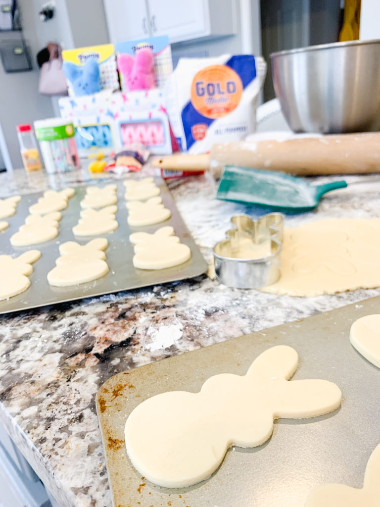 Brianna K's easter cookies shaped like Peeps bunnies in the kitchen with sugar cookie icing that hardens and sprinkles. Brianna K Bitsofbri bits of bri blog easter cook recipe butter cookie cut out cookie sugar cookie recipe icing that hardens peeps bunnies bunny easter cookie recipe 2019