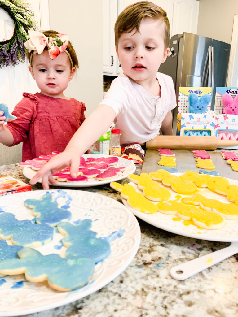 Brianna K's kids Landon and Presley making easter cookies shaped like Peeps bunnies in the kitchen with sugar cookie icing that hardens and sprinkles. Brianna K Bitsofbri bits of bri blog easter cook recipe butter cookie cut out cookie sugar cookie recipe icing that hardens peeps bunnies bunny easter cookie recipe 2019