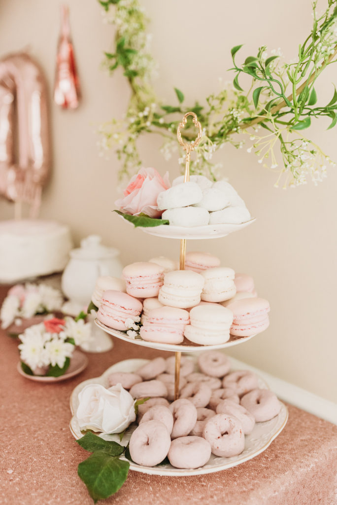 Macaroons and mini donuts on white tiered tray TEA FOR TWO   PRESLEY'S SECOND BIRTHDAY DECORATIONS + PARTY IDEAS! Brianna K bitsofbri blog