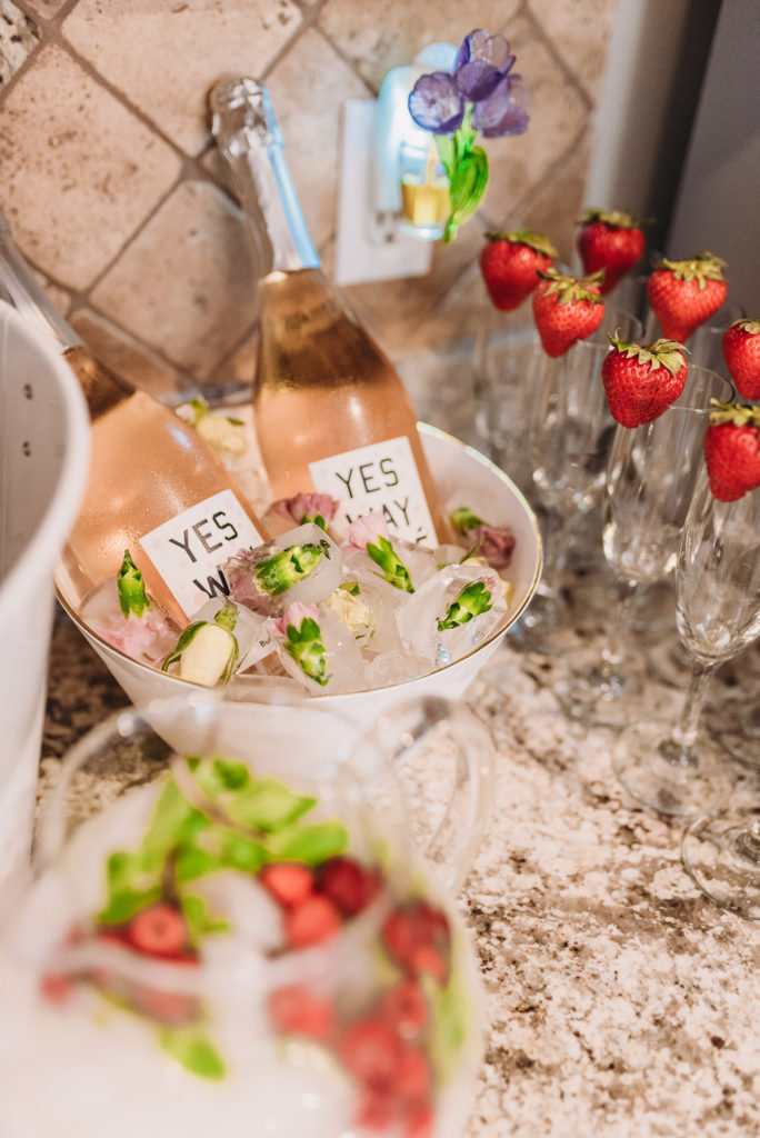 Flowers froze in ice cubes on the Mimosa bar aka Minnie-osa bar with juice and champagne and polka dot napkins TEA FOR TWO | PRESLEY'S SECOND BIRTHDAY DECORATIONS + PARTY IDEAS! Brianna K bitsofbri blog