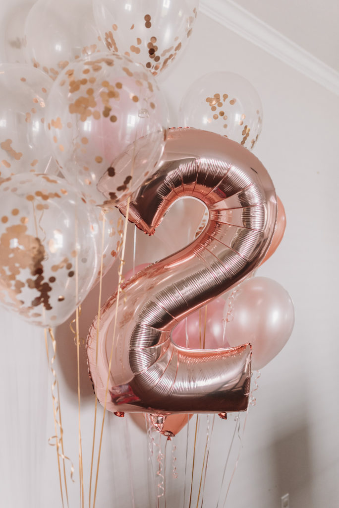 rose gold 2 balloon with other rose gold confetti balloons around it TEA FOR TWO | PRESLEY'S SECOND BIRTHDAY DECORATIONS + PARTY IDEAS! Brianna K bitsofbri blog