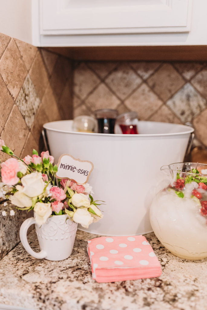 Mimosa bar aka Minnie-osa bar with juice and champagne and polka dot napkins TEA FOR TWO | PRESLEY'S SECOND BIRTHDAY DECORATIONS + PARTY IDEAS! Brianna K bitsofbri blog