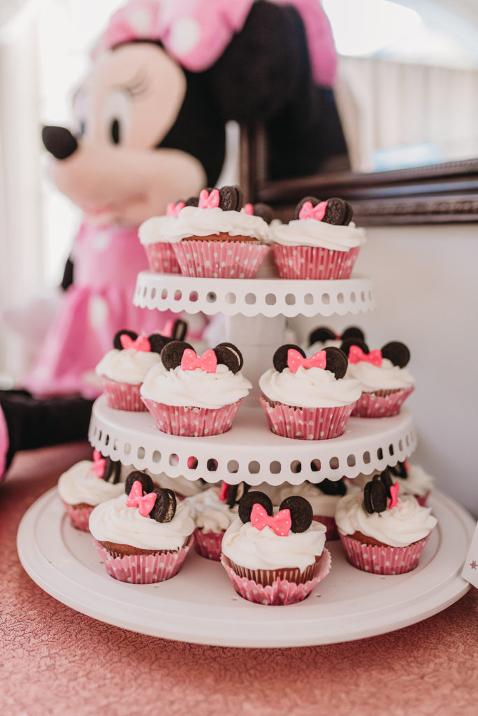Minnie Mouse cupcakes with pink polkadot muffin cups and mini Oreos and fondant pink polkadot bows from Etsy TEA FOR TWO   PRESLEY'S SECOND BIRTHDAY DECORATIONS + PARTY IDEAS! Brianna K bitsofbri blog