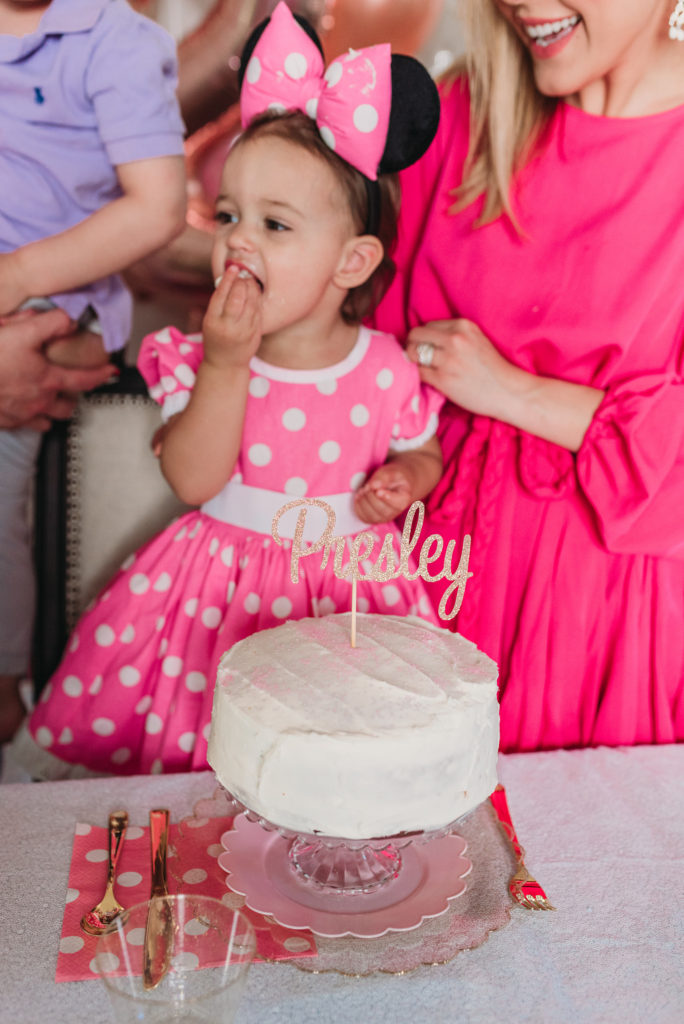 Presley eating her birthday cake at two year old birthday party TEA FOR TWO   PRESLEY'S SECOND BIRTHDAY DECORATIONS + PARTY IDEAS! Brianna K bitsofbri blog