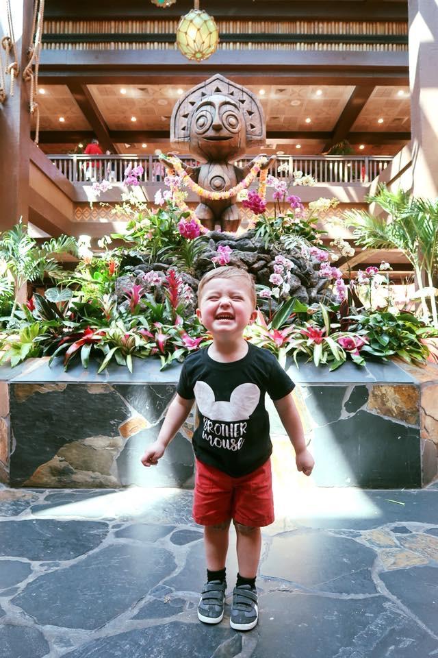Landon in the Disney's Polynesian Resort hotel lobby Where to stay at Disney World blog post by Brianna K bitsofbri blog