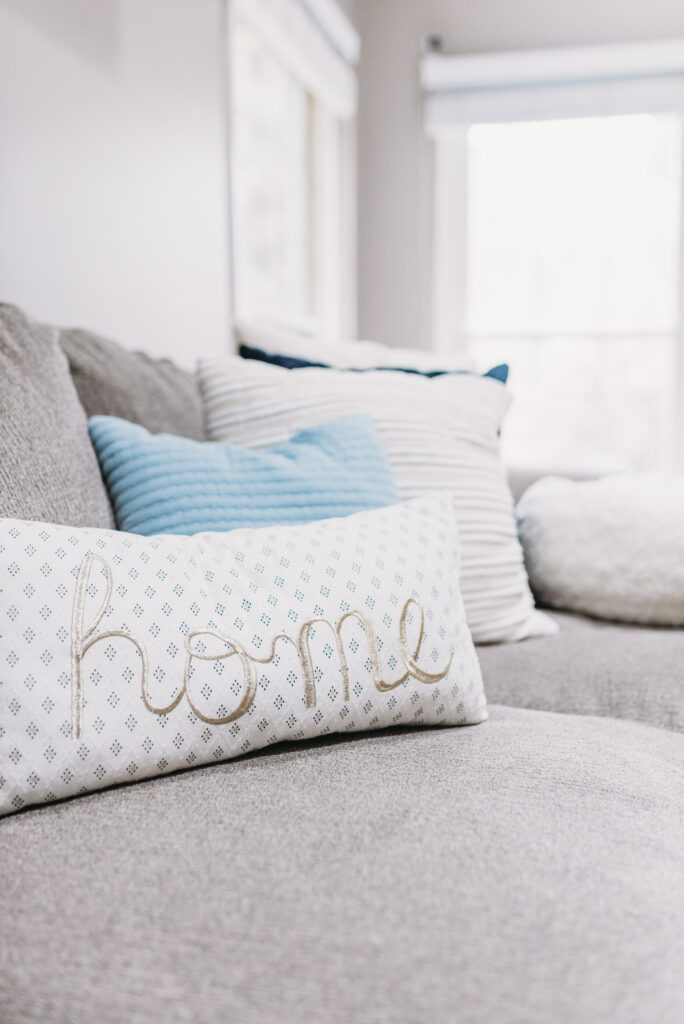 home pillow on couch. Bitsofbri Brianna K summer decor home tour 2019 blog post summer decor inspiration