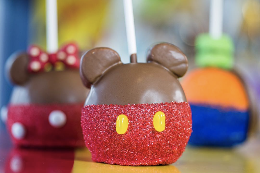 Best snacks you have to try at Walt Disney World | Disney Blog series by Brianna K bits of bri blog  Chocolate covered caramel apples that look like mickey Minnie and goofy