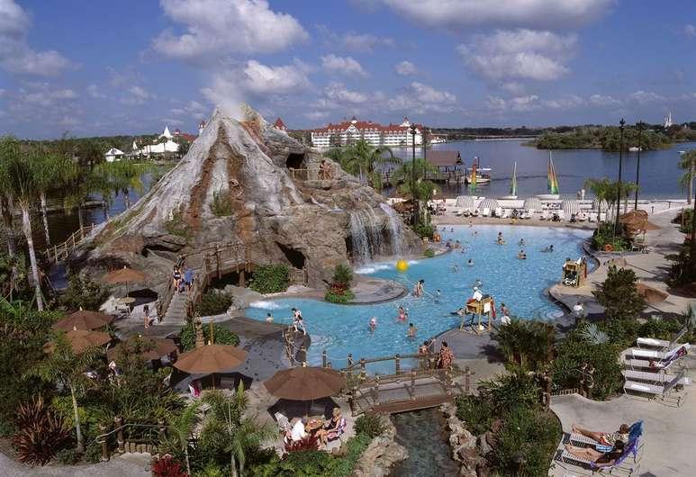 Disney's Polynesian resort pool with Lava volcano and waterfall slides on Bay Lake. Where to stay at Disney World blog post by Brianna K bitsofbri blog