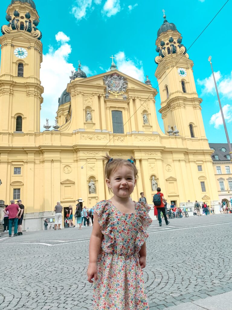 Presley in front of German Church in Munich MUNICH, GERMANY TRAVEL DIARY | 4-DAY ITINERARY AND TRAVEL TIPS Brianna K bitsofbri young family traveling the world