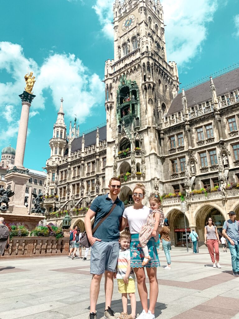 Adam, Brianna, Landon, and Presley in front of the Rathaus Glockenspiel in Marienplatz in the center of old town Munich. MUNICH, GERMANY TRAVEL DIARY | 4-DAY ITINERARY AND TRAVEL TIPS Brianna K bitsofbri young family traveling the world