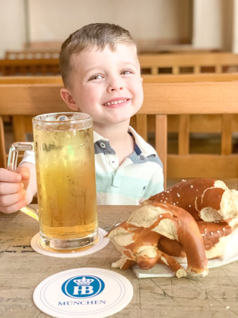 Landon with a Bavarian pretzel and apple juice in a beer mug at the original Hofbrauhaus in Munich Germany MUNICH, GERMANY TRAVEL DIARY | 4-DAY ITINERARY AND TRAVEL TIPS Brianna K bitsofbri young family traveling the world