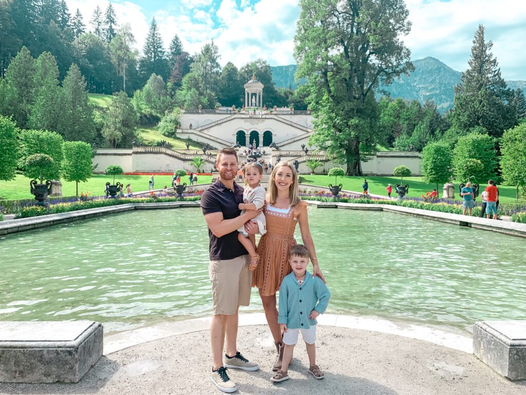 Adam, Brianna, Landon, and Presley visiting the Linderhof Palace ground in Bavaria, Germany MUNICH, GERMANY TRAVEL DIARY | 4-DAY ITINERARY AND TRAVEL TIPS Brianna K bitsofbri young family traveling the world