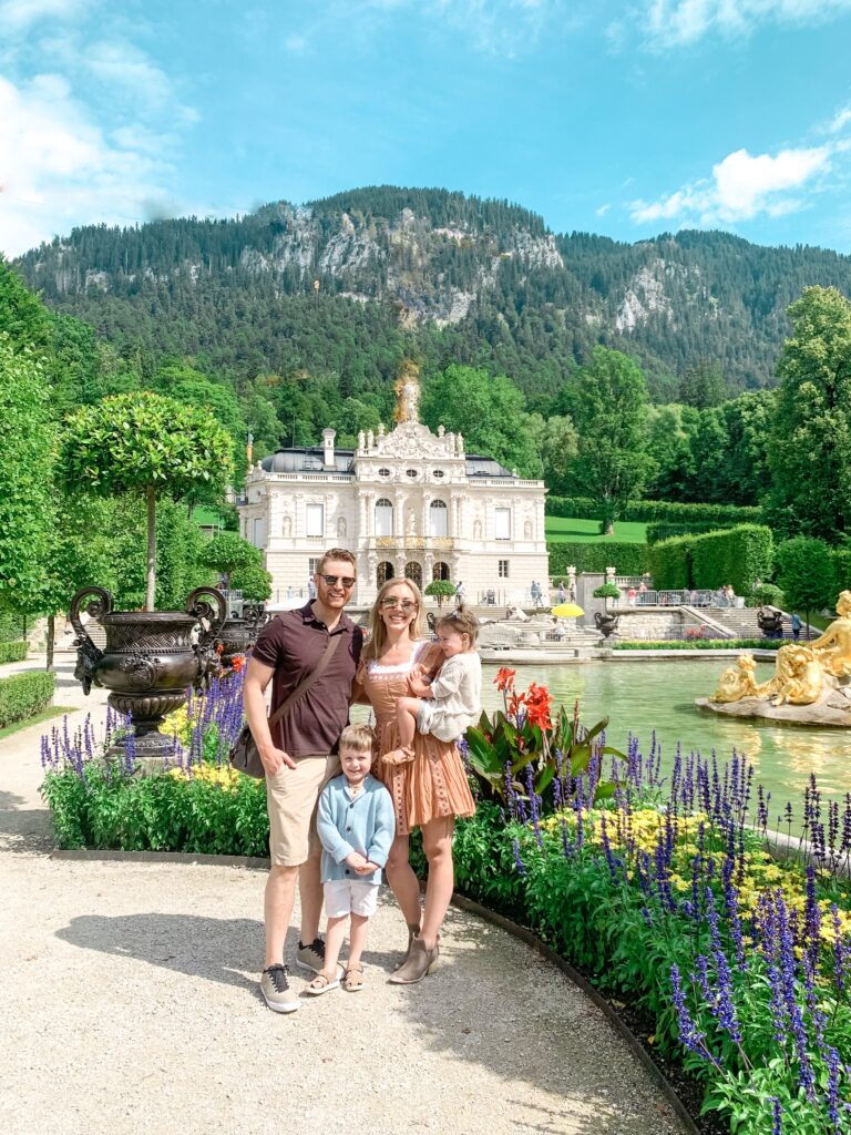 Adam, Brianna, Landon, and Presley in front of Linderhof Palace on Bavarian Castle tour | MUNICH, GERMANY TRAVEL DIARY | 4-DAY ITINERARY AND TRAVEL TIPS Brianna K bitsofbri young family traveling the world