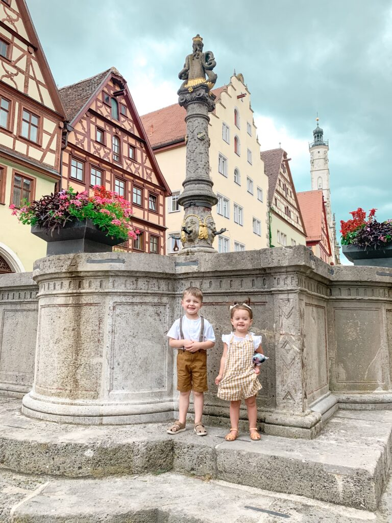 Landon and Presley in front of fountain in the center of town in Rothenburg Ob Der Tauber | MUNICH, GERMANY TRAVEL DIARY | 4-DAY ITINERARY AND TRAVEL TIPS Brianna K bitsofbri young family traveling the world