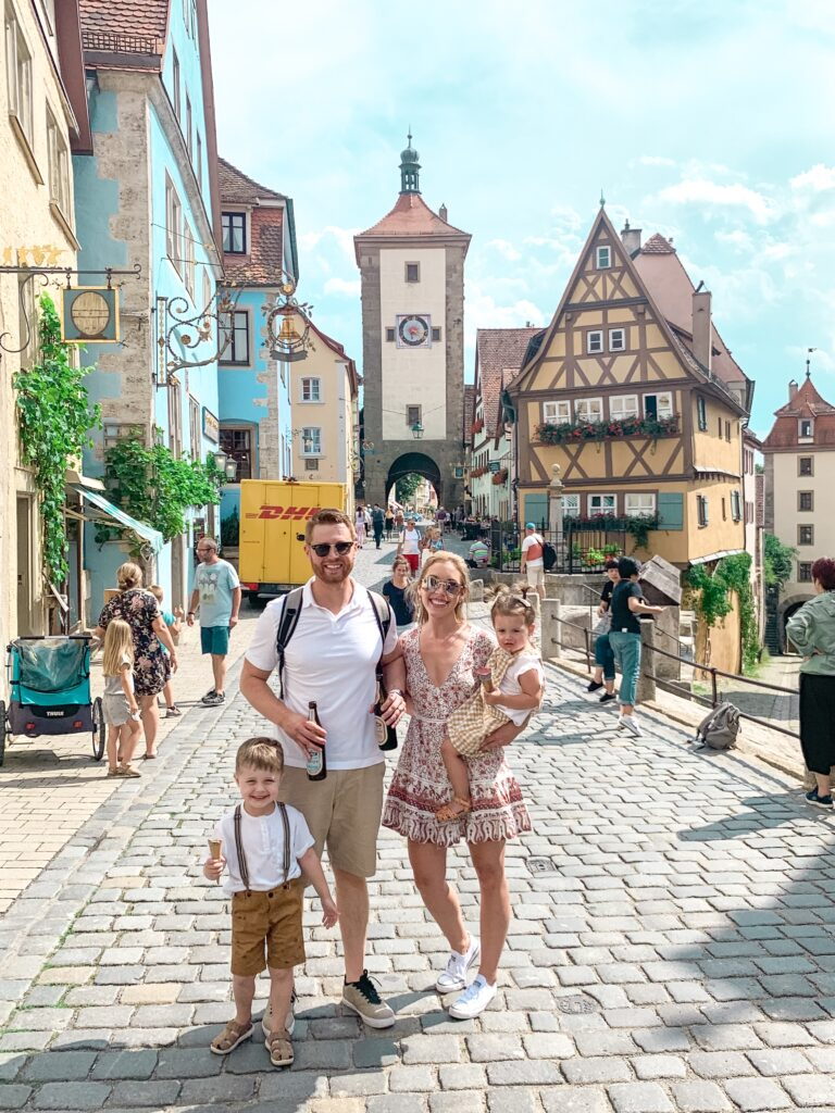Adam, Brianna, Landon, and Presley by the famous clocktower in Rothenburg Ob Der Tauber MUNICH, GERMANY TRAVEL DIARY | 4-DAY ITINERARY AND TRAVEL TIPS Brianna K bitsofbri young family traveling the world
