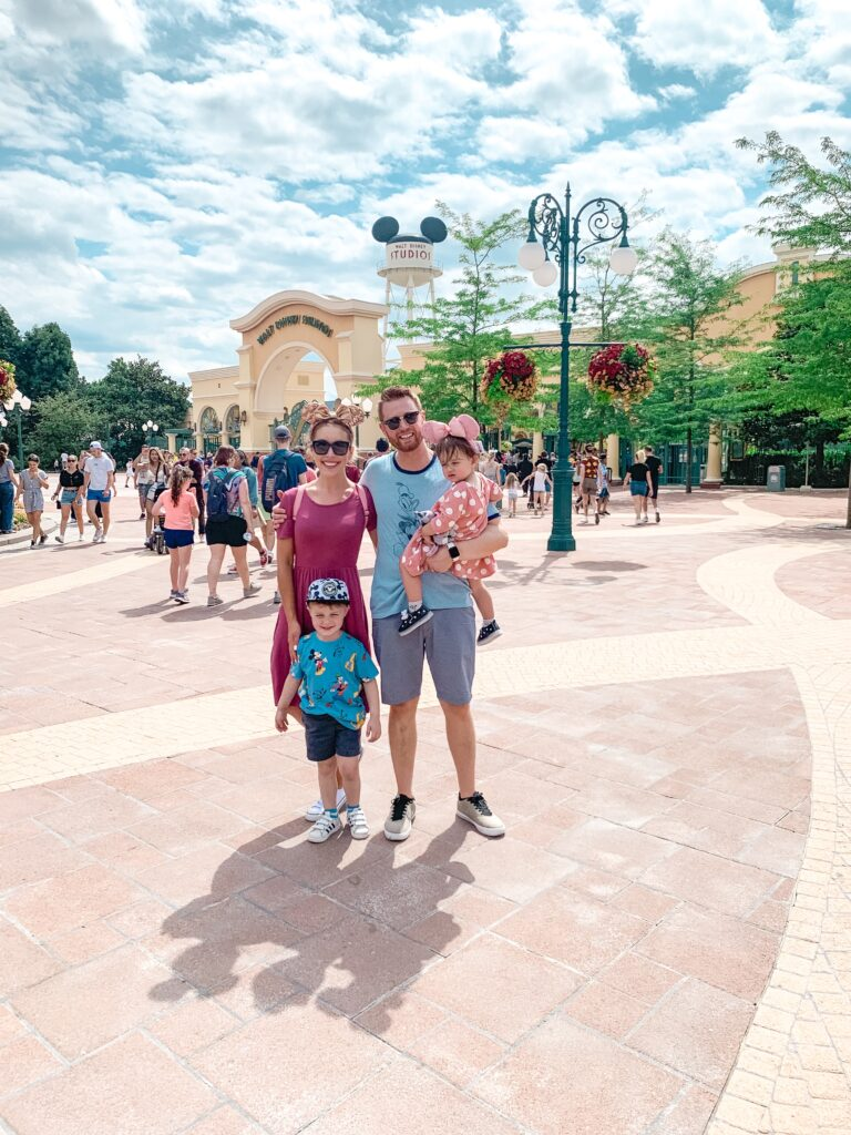 Adam Brianna K Landon and Presley family in front of Walt Disney Studios at Disneyland Paris Brianna K bitsofbri blog Paris Travel Diary