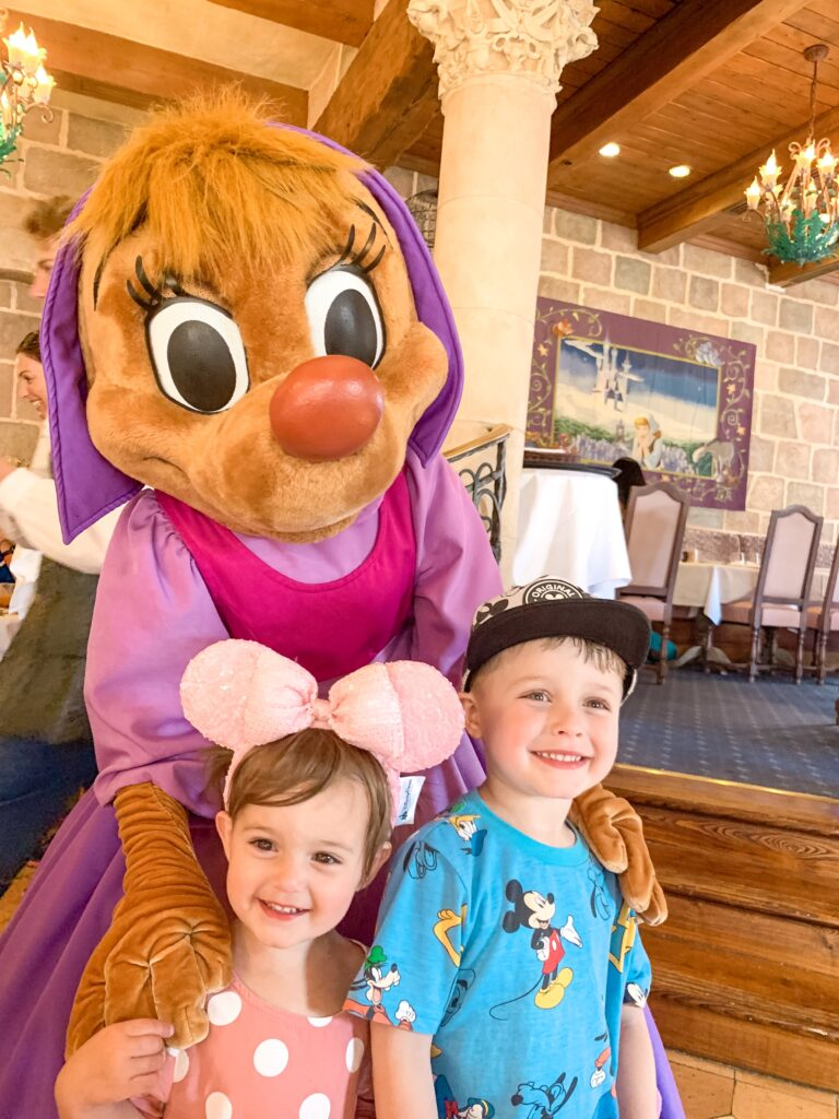 little boy and little girl with one of Cinderella's mice at Auberge de Cendrillon at Disneyland Paris Brianna K bitsofbri blog Paris Travel Diary