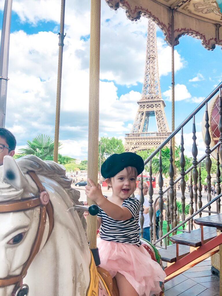 PRESLEY little girl riding carousel in front of Eiffel Tower instagram picture ideas in Paris Brianna K bitsofbri blog Paris Travel Diary