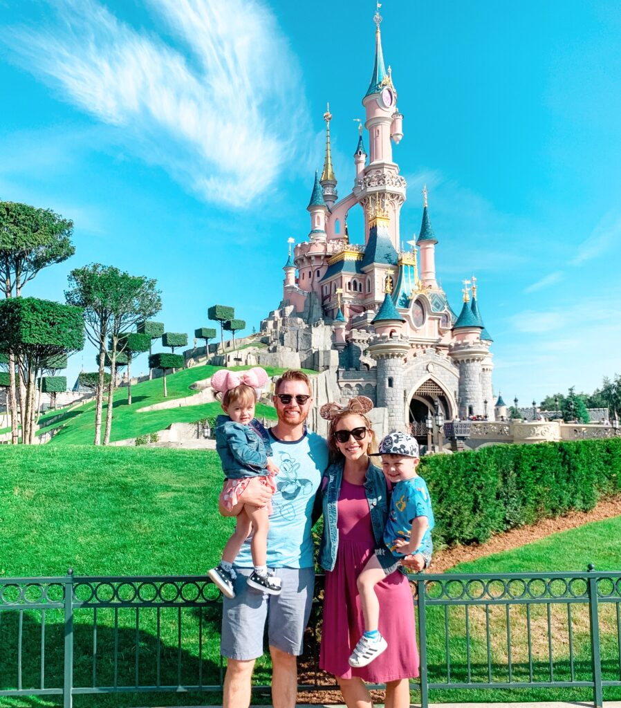 Brianna K Adam Landon and Presley in front of Sleeping Beauty's castle at Disneyland Paris summer 2019 bitsofbri disney blog