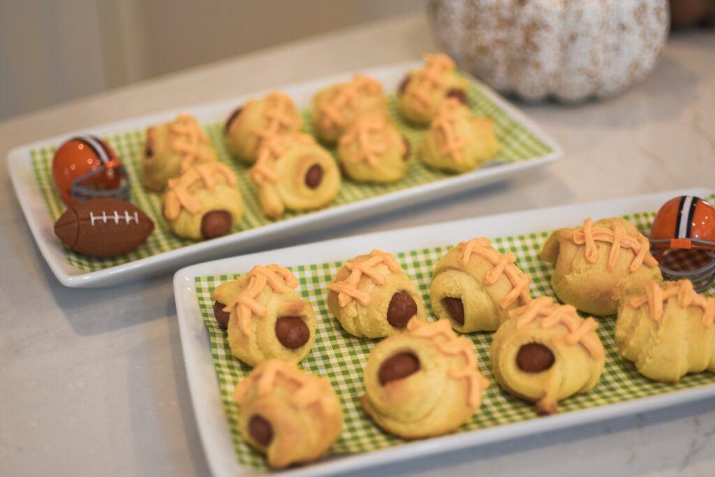 """""""PIGSKINS"""" IN A BLANKET! SO EASY TO MAKE!! NFL Football game food ideas for any football party tailgate or Super Bowl party food recipes - easy DIY treats for football games Brianna K bitsofbri Bits of Bri blog pigs in a blanket stadium dip football brownies Cleveland Ohio stay at home mom"""