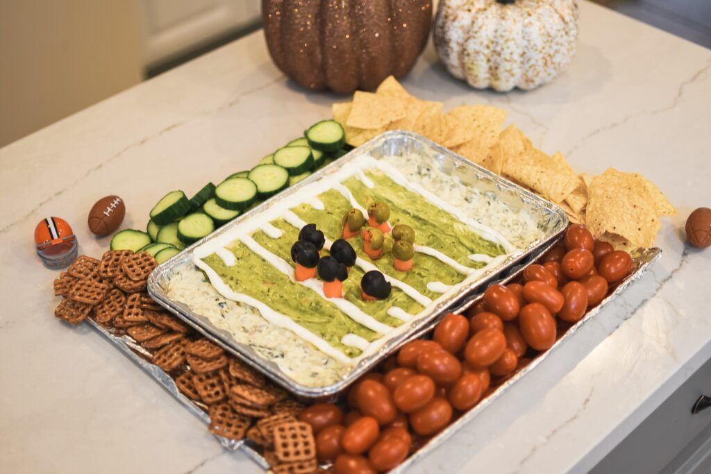 STADIUM DIP! SO EASY TO MAKE! NFL Football game food ideas for any football party tailgate or Super Bowl party food recipes - easy DIY treats for football games Brianna K bitsofbri Bits of Bri blog pigs in a blanket stadium dip football brownies Cleveland Ohio stay at home mom