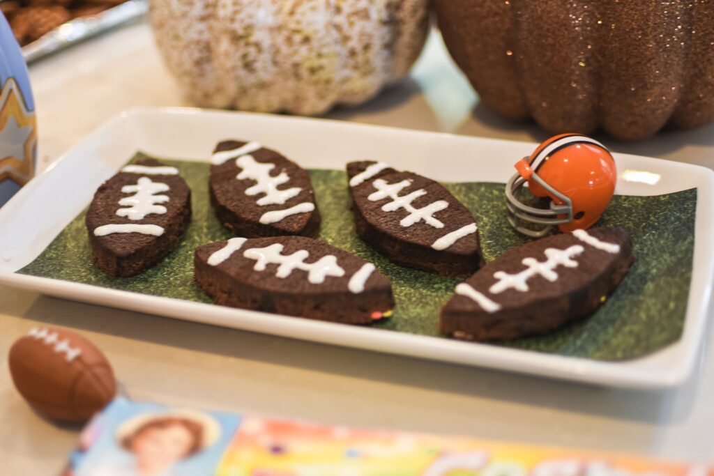 Football Brownies- SO EASY TO MAKE!!!! NFL Football game food ideas for any football party tailgate or Super Bowl party food recipes - easy DIY treats for football games Brianna K bitsofbri Bits of Bri blog pigs in a blanket stadium dip football brownies Cleveland Ohio stay at home mom
