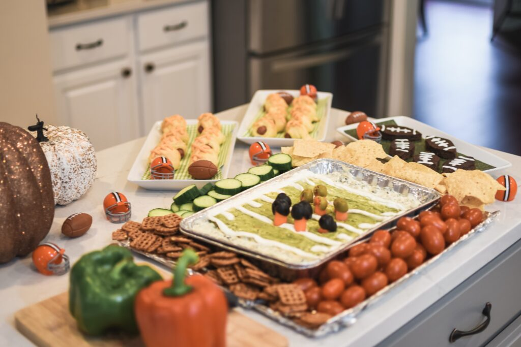 NFL Football game food ideas for any football party tailgate or Super Bowl party food recipes - easy DIY treats for football games Brianna K bitsofbri Bits of Bri blog pigs in a blanket stadium dip football brownies Cleveland Ohio stay at home mom
