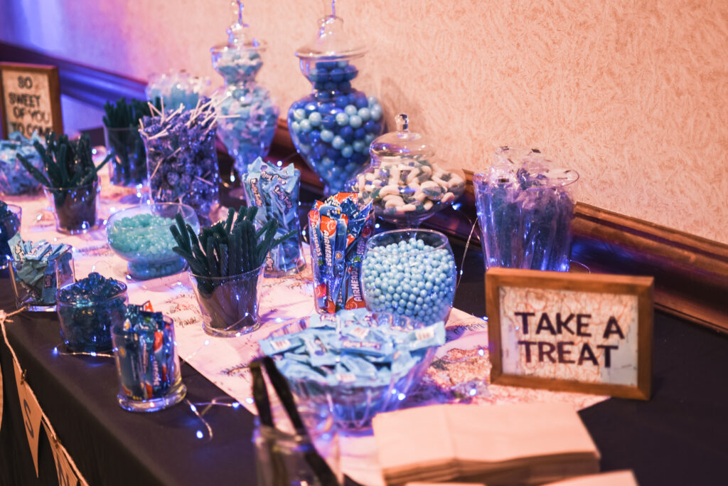 all blue candy party with light up blue twinkle lights party favors travel theme party decor decorations for a travel themed around the world bar mitzvah celebration Brianna K bits of Bri party planner